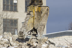 Building demolition. Demolition of a building at construction site Stock Photos
