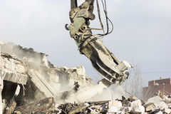 Building demolition. Demolition of a building at construction site Royalty Free Stock Images