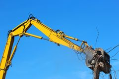 Building demolition crane. Large demolition crane dismantling a building Royalty Free Stock Image