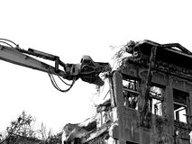 Building demolition with excavator,black and white style. Building demolition with hydraulic excavator Stock Images