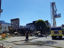 Building demolition after fire. Demolition on the remains of a building ravaged by a fire in Victoria, BC, Canada on May 6, 2019 royalty free stock photo