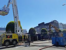 Building demolition after fire. Demolition on the remains of a building ravaged by a fire in Victoria, BC, Canada on May 6, 2019 stock images