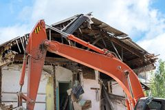 Building demolition with hydraulic excavator. dismantling an old. Dismantling an old residential house. building demolition with hydraulic excavator Stock Photography