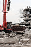 Building demolition by machinery for new construction. Stock Image