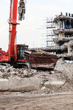 Building demolition by machinery for new construction. Stock Images