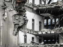 Building demolition by machinery for new construction. Stock Photo