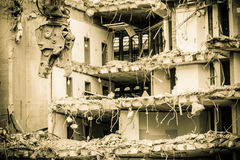 Building demolition by machinery for new construction. Royalty Free Stock Photo