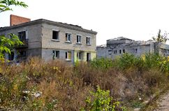 Building is destroyed by projectiles and mines. Houses were destroyed by military operations. Projectiles got in building. People do not live royalty free stock photo