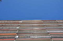 The building is directed to the sky. Multi-storey building. The building is directed to the sky. A multi-storey building against a blue sky with white clouds Stock Photos