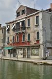 Building in disrepair. Facade of building in disrepair on  a canal in Murano, an island in the Venetian Lagoon, northern Italy Royalty Free Stock Photo