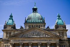 Building dome. Domes of a building of court of a city of Leipzig against the blue summer sky Royalty Free Stock Images