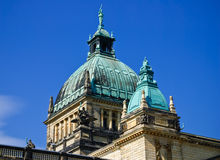 Building dome. Domes of a building of court of a city of Leipzig against the blue summer sky Stock Image