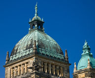 Building dome. Domes of a building of court of a city of Leipzig against the blue summer sky Royalty Free Stock Photos