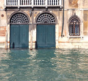 Building doors flooded by high water in Venice Royalty Free Stock Photography