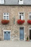 Building doors and red flowers in Aachen. An ordinary street scene in Aachen Stock Images