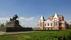 Building of the Drama Theatre. Built in traditional Russian style and monument to the cavalry. Urban landscape. Russia, Samara Stock Photos