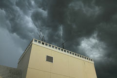Building with dramatic dark clouds Royalty Free Stock Photography