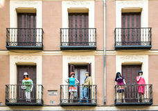 Building with dresed manequins on balconies on a street of Madri Royalty Free Stock Photography