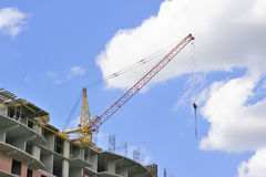 Building with elevating crane Royalty Free Stock Image