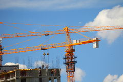 Building with elevating cranes Stock Photography