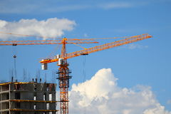 Building with elevating cranes Stock Images