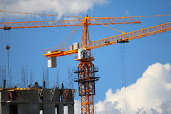 Building with elevating cranes Stock Photos