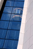Building with Elevator in Window. Blue and white building with elevator moving in the the windows royalty free stock photo