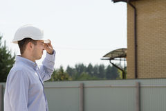 Building Engineer at Site Monitoring Construction Royalty Free Stock Images