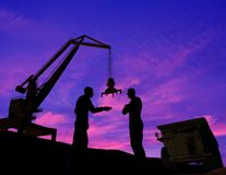 Building engineering. And workers on a background of the sky Stock Photography