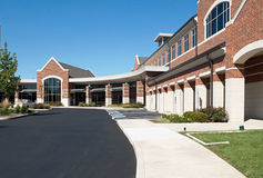 Building Entrance Drive. Drive & covered walkway leading to the main entrance of business building Stock Photography