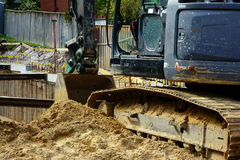 Building Excavation. Large digger, excavator, excavating a residential building site Royalty Free Stock Images