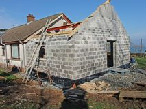 Building extension. Building an extension to a house home with blocks, concrete bricks ad timber bungalow Stock Images