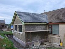 Building extension. Building an extension to a house home with blocks, concrete bricks ad timber bungalow Royalty Free Stock Photography