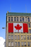 Building Exterior with Canadian Flag. The exterior of a building with a giant Canadian flag affixed to its side royalty free stock images