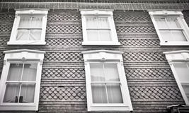 Building exterior. Exterior of an english urban building with tall window frames Royalty Free Stock Images