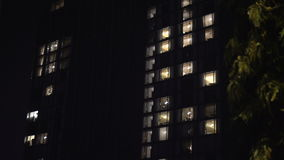 Building exterior in the evening with interior lights. Abstract urban video background stock video footage
