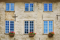 Building facade. The facade of the old building with six windows in Riga, Latvia royalty free stock photography