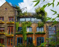 Building facade. Full of colourful plants Royalty Free Stock Photos