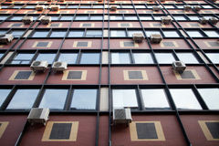 Building facade with air conditioners Stock Image