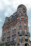 Building facade decorated with red and yellow brick in Paris Stock Photo
