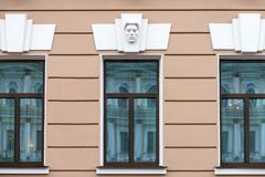 Building facade decoration - face above window. RUSSIA, SAINT PETERSBURG - AUGUST 18, 2017: Building facade decoration - face above window. Lane Antonenko, 2 Royalty Free Stock Image