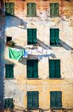 Building facade hanging cloths. Italy Royalty Free Stock Images
