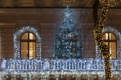 Building facade with light decoration at night with Christmas tr Royalty Free Stock Image