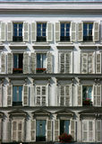 Building facade in Paris. White neoclassical facade of a Paris downtown building Royalty Free Stock Image