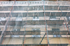Building facade renovation with green protective net Stock Image