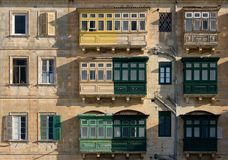 Building Facade In Valletta, Malta. Partly renewed balconies on buildings in Valletta, Malta Royalty Free Stock Photo