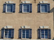 Building facade with windows. Above retail store Royalty Free Stock Images