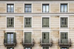 Building facade, 12 windows. Twentieth-century style. Stock Photos
