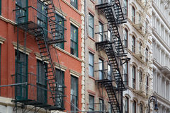 Building facades with fire escape stairs in New York Stock Photo