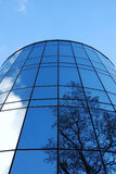 Building with facets. Modern office building in munich with reflections of a tree Royalty Free Stock Photo